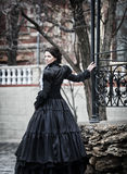 Outdoors portrait of a victorian lady in black royalty free stock photo