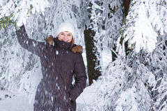 Outdoors portrait of young beautiful woman having fun in winter. Stock Images