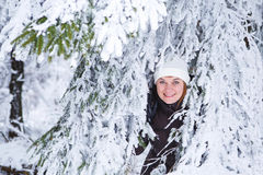 Outdoors portrait of young beautiful woman having fun in winter. Royalty Free Stock Image