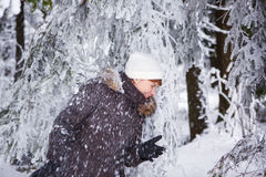 Outdoors portrait of young beautiful woman having fun in winter. Stock Photos