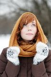 Outdoors portrait of young beautiful woman. In winter Royalty Free Stock Images