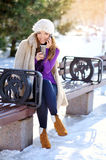 Outdoors portrait of young beautiful woman in winter Royalty Free Stock Image