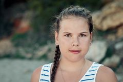 Outdoors portrait of young brunette girl. Royalty Free Stock Photos