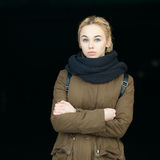 Outdoors portrait of young naughty beautiful blonde hipster woman in olive parka with a dreadlocks bun hairstyle Stock Images