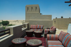 Outdoors restaurant comfortable lounge on the top of the roof at luxury arabian desert resort Royalty Free Stock Images