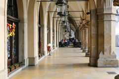 The outdoors restaurant under arcades in Krakow Royalty Free Stock Photography