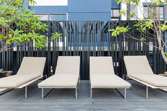 Outdoors seating arrangement in relaxation zone at modern building Stock Image