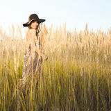 Outdoors sunrise shot of beautiful young model in tallgrass meadow Royalty Free Stock Photography