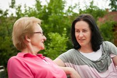 Outdoors talking - women Royalty Free Stock Photography