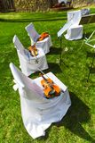 Outdoors wedding ceremony - string quartet's chairs with instrum Royalty Free Stock Images