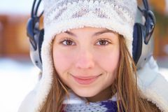 Outdoors on a winter day. Girl listen music. Stock Image