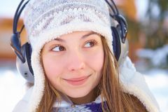 Outdoors on a winter day. Woman listening music. Stock Image