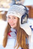 Outdoors on a winter day. Woman listening music. Stock Images