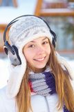 Outdoors on a winter day. Woman listening music. Stock Photography