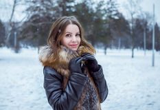 Outdoors winter portrait of beautiful young smiling woman Stock Photos