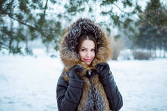 Outdoors winter portrait of beautiful young smiling woman Royalty Free Stock Image