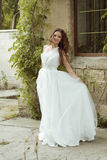 Outdoors woman portrait. Beautiful  bride in luxurious white wed Royalty Free Stock Photography