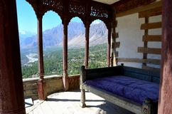 Outdoors wooden room Baltit Fort Karimabad Hunza Gilgit Baltistan Pakistan. Karmibad, Pakistan - September 28, 2016: A sofa with a purple mattress in a balcony Stock Images