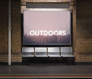 Outdoors word on nature background with trees Concept Stock Photos