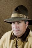 Outdoorsman. Portrait of Outdoorsman with jacket and a Big Hat stock images