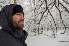 Outdoorsman. A close up of a man outdoors in the snow-covered forest Royalty Free Stock Photography