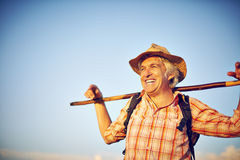 Outdoorsman summer meadow man hat Royalty Free Stock Image