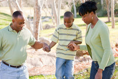 Outdoorsy African American Family Playing Outside Royalty Free Stock Image