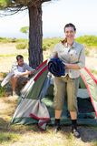 Outdoorsy couple setting up camp in the countryside Royalty Free Stock Photos