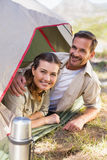 Outdoorsy couple smiling at camera from inside their tent Stock Photo