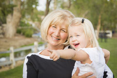 Outdoorsy Grandmother and Granddaughter Playing At The Park Royalty Free Stock Image