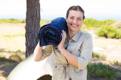 Outdoorsy woman smiling at camera outside her tent Royalty Free Stock Images