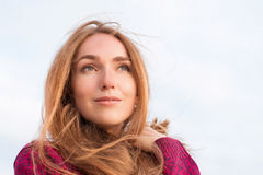 Outdor portrait of serene beautiful woman with long hair flutter Stock Photography