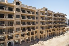 Exterior of an apartment block construction in tropical resort. Oute exterior of an apartment block construction project in tropical holiday resort Stock Photo