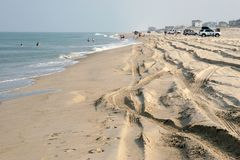 Outer Banks Beach, North Carolina. Parts of the North Carolina Outer Banks have no roads and people must drive their vehicles on the beach to access their homes Stock Photos