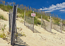 Outer Banks Beach Sand Dunes. A sign warns visitors to keep off the protective sand dunes at the Nags Head beach at the Outer Banks of North Carolina Stock Photo