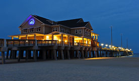 Outer Banks Fishing Pier. A nighttime view of Jennettes Fishing Pier on the shore of the Outer Banks in North Carolina Stock Images