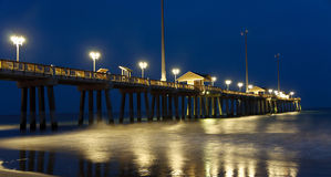 Outer Banks Fishing Pier at night. A nighttime view of the fishing pier on the shore of the Outer Banks in North Carolina Royalty Free Stock Photos
