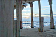 The Outer Banks has many wonderfully active beach piers that actively bring fisher persons and beachgoers to the shore. The Myrtle Beach, North Carolina pier on stock photos