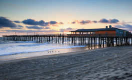 Outer Banks North Carolina Fishing Pier. The Outer Banks Fishing Pier in Nags Head, North Carolina at sunrise on the Outer Banks royalty free stock image