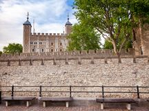 Outer curtain wall of The Tower of London with the White Tower i. The outer curtain wall and the White Tower of the Tower of London  - historic castle and Stock Image