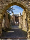 The outer entrance to Hengebach Castle in Heimbach, Germany. Entrance path to Hengebach Castle in Heimbach, North Rhine-Westphalia, Germany stock photography