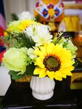 Sunflower near roses in vase decor in the rest room. royalty free stock photos