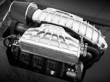Outer supercharger, air compressor on sport car Royalty Free Stock Image