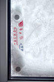 Outer thermometer on a frozen window Royalty Free Stock Photos
