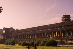 Outer wall of Angkor Wat with Sunrise Stock Photos