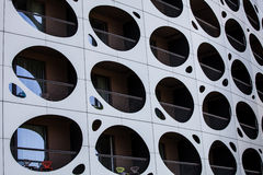 Outer wall modern building. Balconies with holes porthole. Stock Images