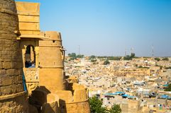 Outer walls of sandstone walls of a fort shot against a cityscap Stock Photography