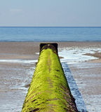 Outfall Pipe. A water outfall pipe on a beach in Cornwall, england royalty free stock images
