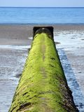 Outfall Pipe. A water outfall pipe on a beach in Cornwall, england stock photography