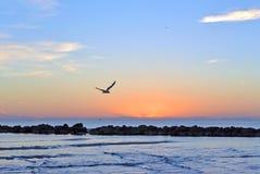 The outfall on sand beach. Beautiful sunrise sky over sea stock photos